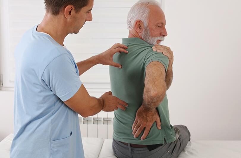 What causes spinal stenosis to flare up